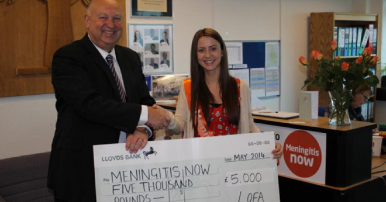 Paul Bevington, LOFA chairman, presents a cheque to Leah Wynn, community fundraiser for Meningitis Now