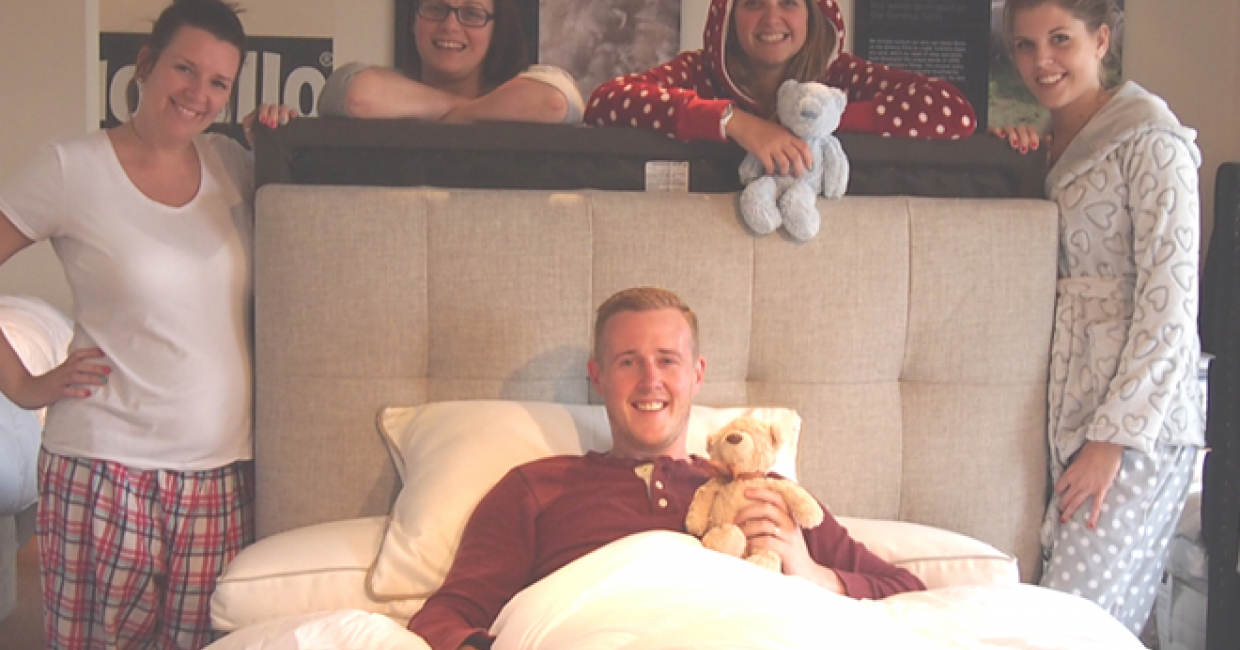 Mike gets cosy at this year's Land of Beds sleepover, together with sales staff Rhian, Rachel, Lauren and Caroline
