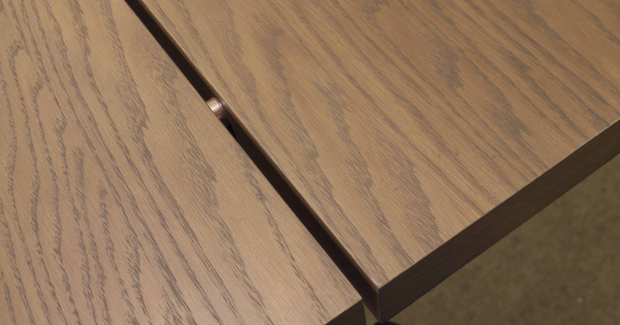 The top of City's six-seater fixed dining table is split into two, with visible brushed steel connectors. An extending model is also available