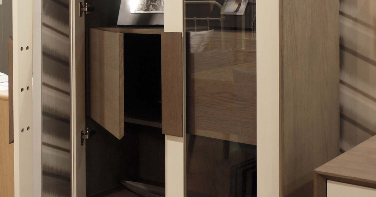 Distinctive handles front the display cabinet, which boasts an internal cupboard