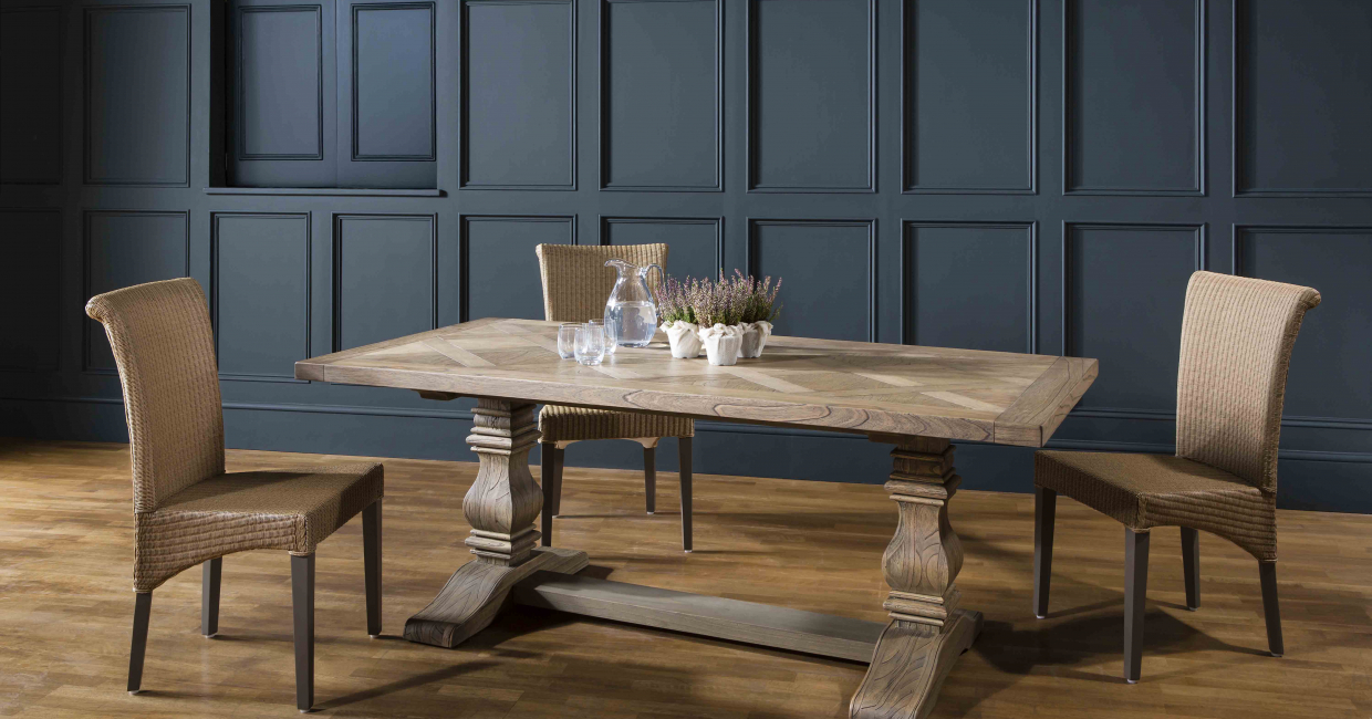 The Hamilton table employs a long-lasting architectural veneer and seats up to 10