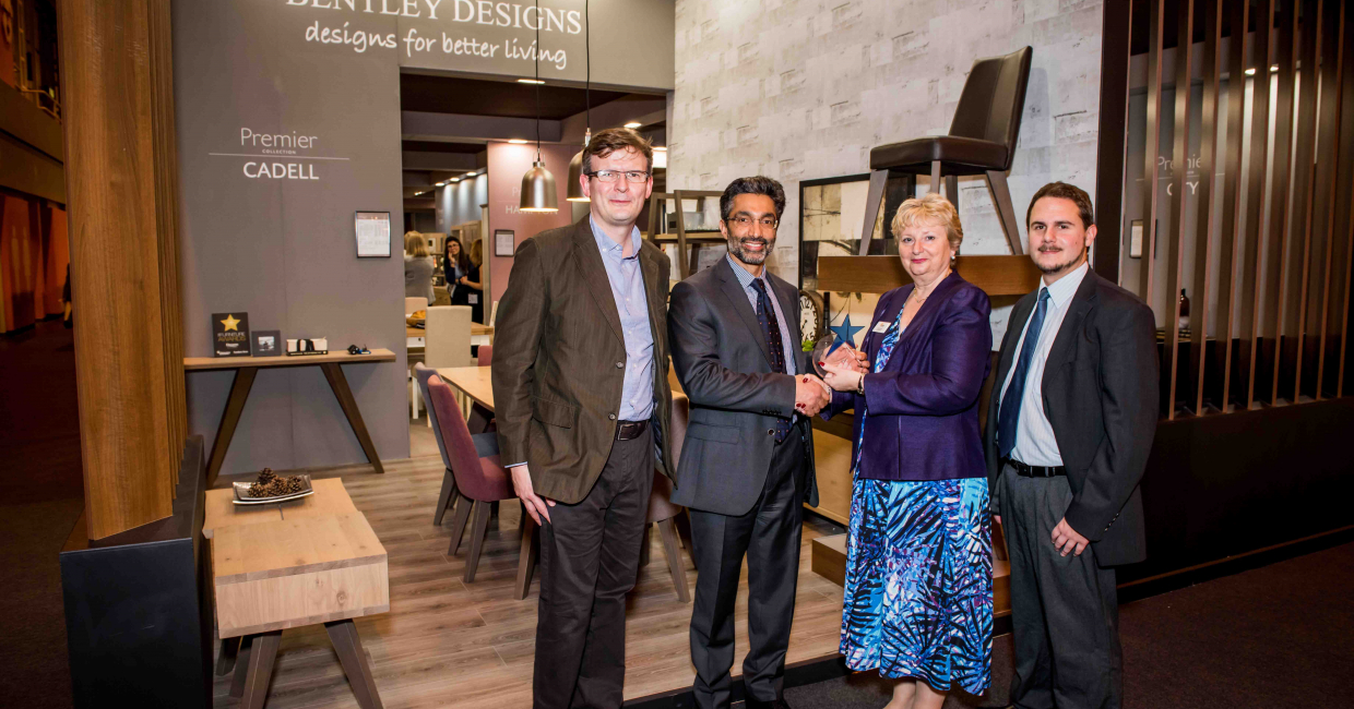 Bentley Designs' design manager Ray Davies and director Rif Lalani receive their award from Laraine Janes and Paul Farley