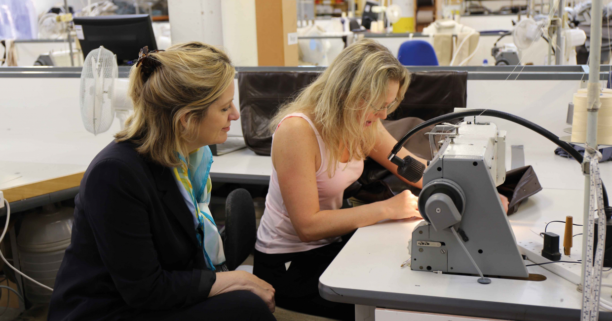 Amber Rudd talking to a (British) sewing machinist during last year's visit. Although Amber has not issued a response to Matt's assertions, she has entered into discussion with the sewing supervisor