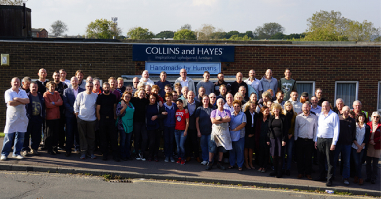 Roughly 70 of Collins and Hayes' employees stand united for Furniture News' camera outside the Hastings showroom