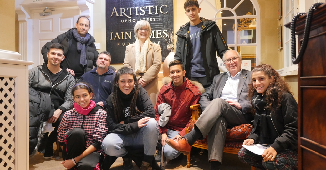 Students visiting Artistic Upholstery, with director Andrew Mitchell