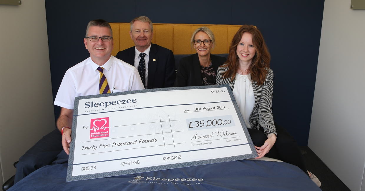 Sleepeezee team presenting cheque to the British Heart Foundation