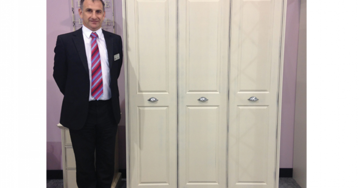 Sean Frost-Palmer, sales director of Kingstown Furniture, with an example of the company's Helena range