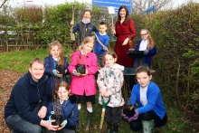 Harrison Spinks plants trees at local school